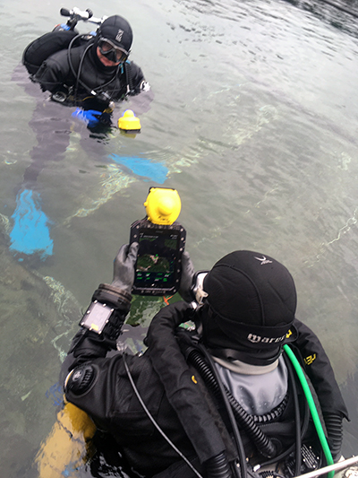 Divers preparing to enter the quarry and navigate using UWIS and tablet